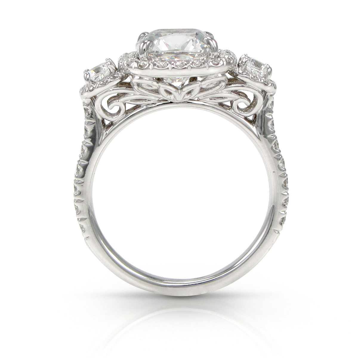 Cushion-cut three-stone ring