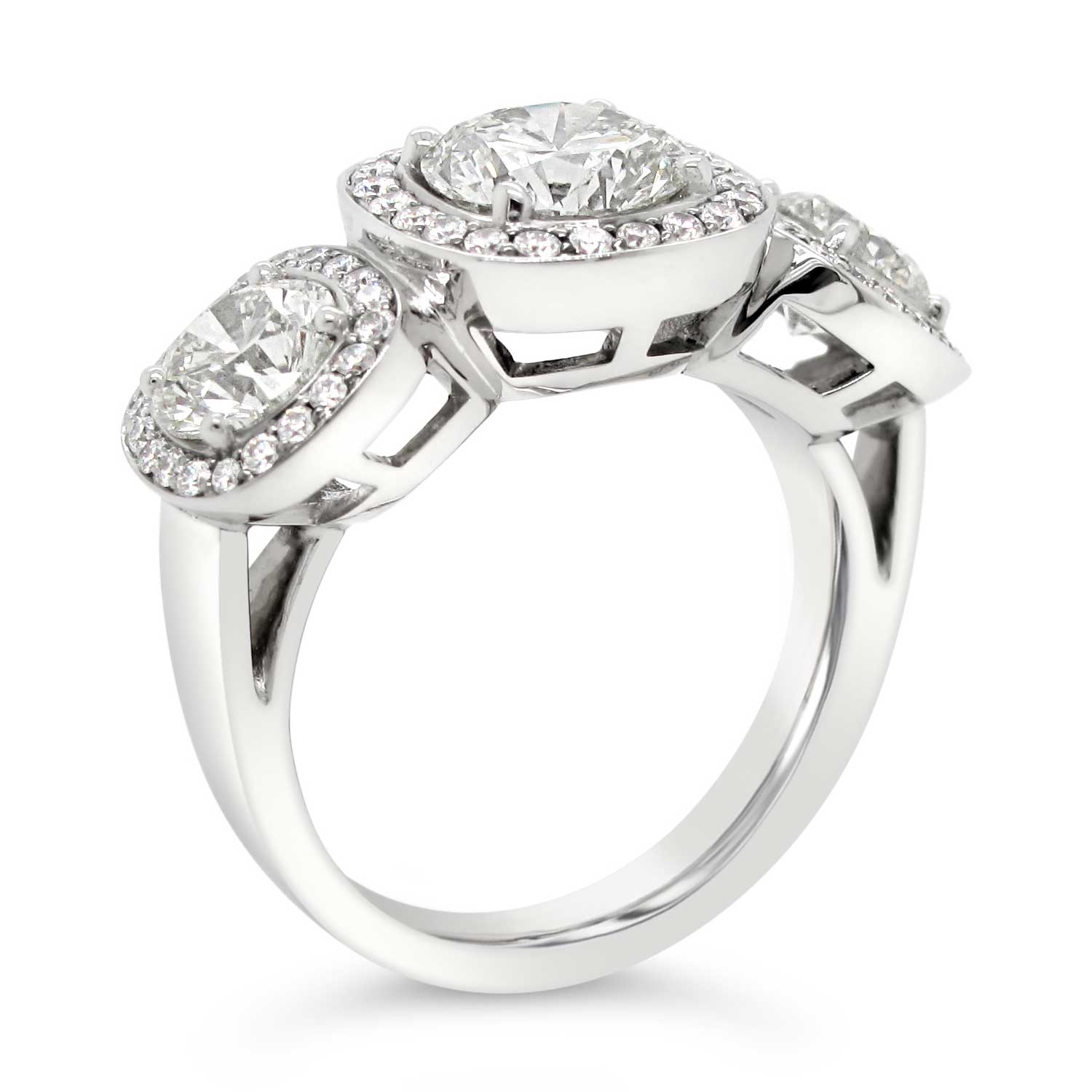 Platinum-3-stone-diamond-ring-with-cushion-diamond-halos