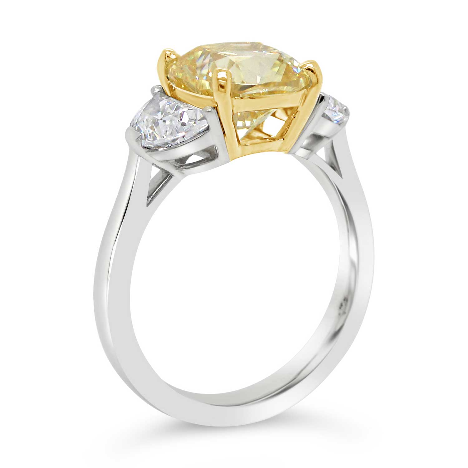 3ct yellow cushion cut center stone with two half-moon cut side stones set in 18k yellow gold and platinum