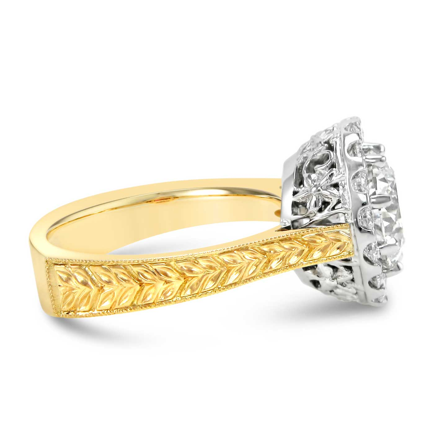 Vintage inspired 19k white and 18k yellow gold engagement ring set with a 2ct center stone and a diamond halo